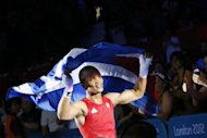 Gold medalist Roniel Iglesias of Cuba departs the ring victorious over Denys Berinchyk of the Ukraine following the light welterweight (64kg) boxing final of the 2012 London Olympic Games at the ExCel Arena