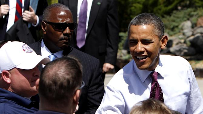 President Barack Obama visits with the crowd during his visit to the home of  Val and Paul Keller,  in Reno, Nev., Friday,  May 11, 2012.  Obama met with the Kellers who recently refinanced their home loan under a federally backed program that the President wants to expand to all homeowners who are paying their mortgages on time.(AP Photo/Rich Pedroncelli)