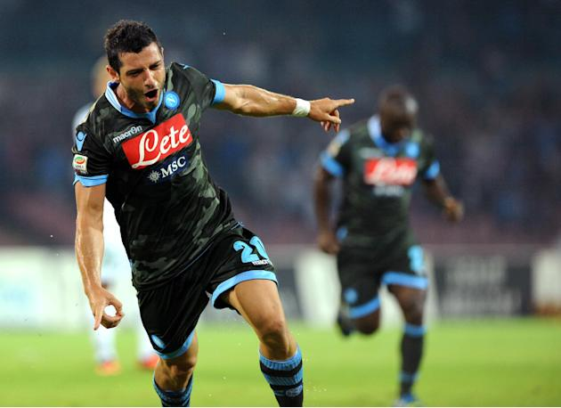 Napoli's Blerim Dzemaili, of Switzerland, celebrates after scoring during a Serie A soccer match between Napoli and Sassuolo, at the Naples San Paolo stadium, Italy, Wednesday, Sept. 25, 2013
