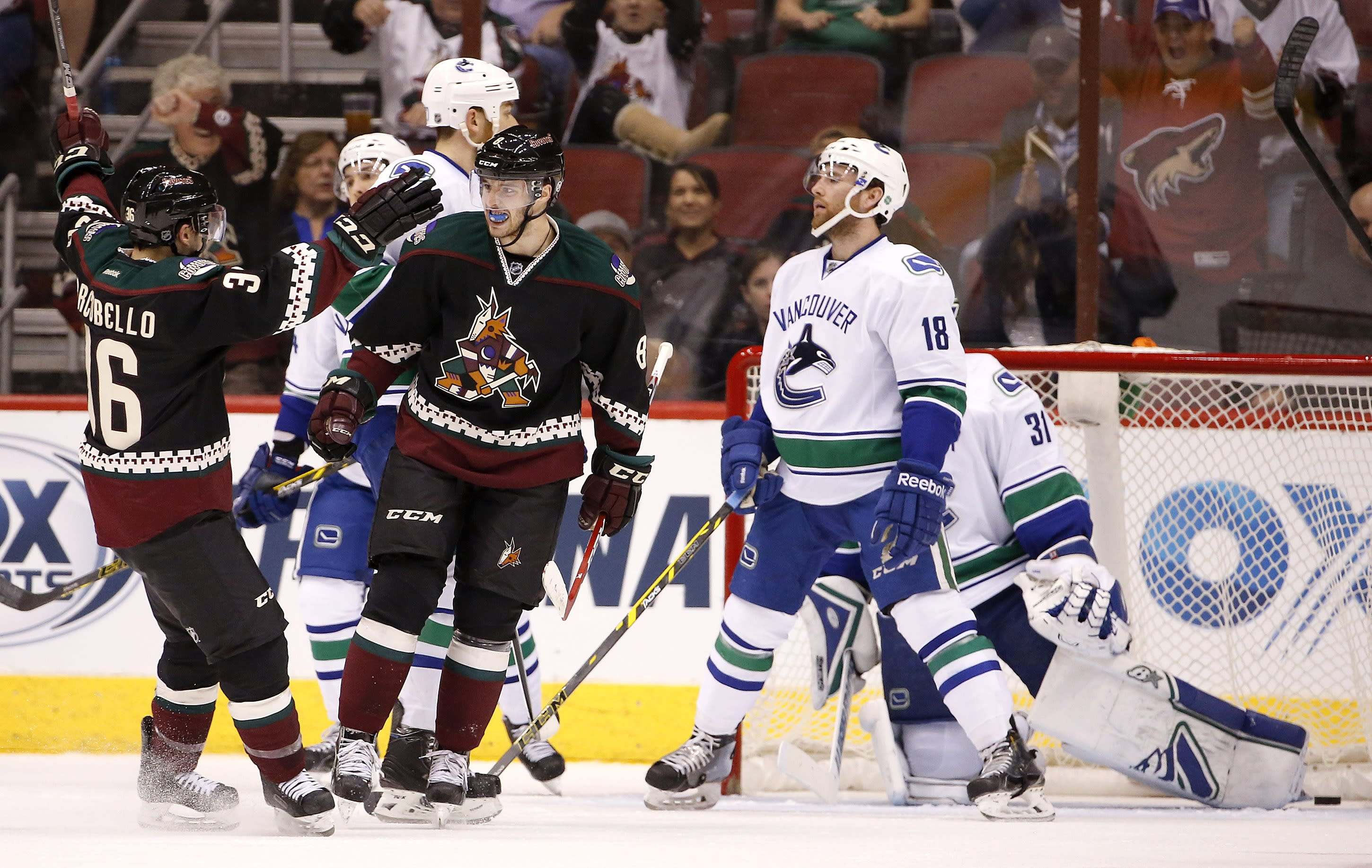 Coyotes end 10-game skid, beat Canucks 3-2 in shootout