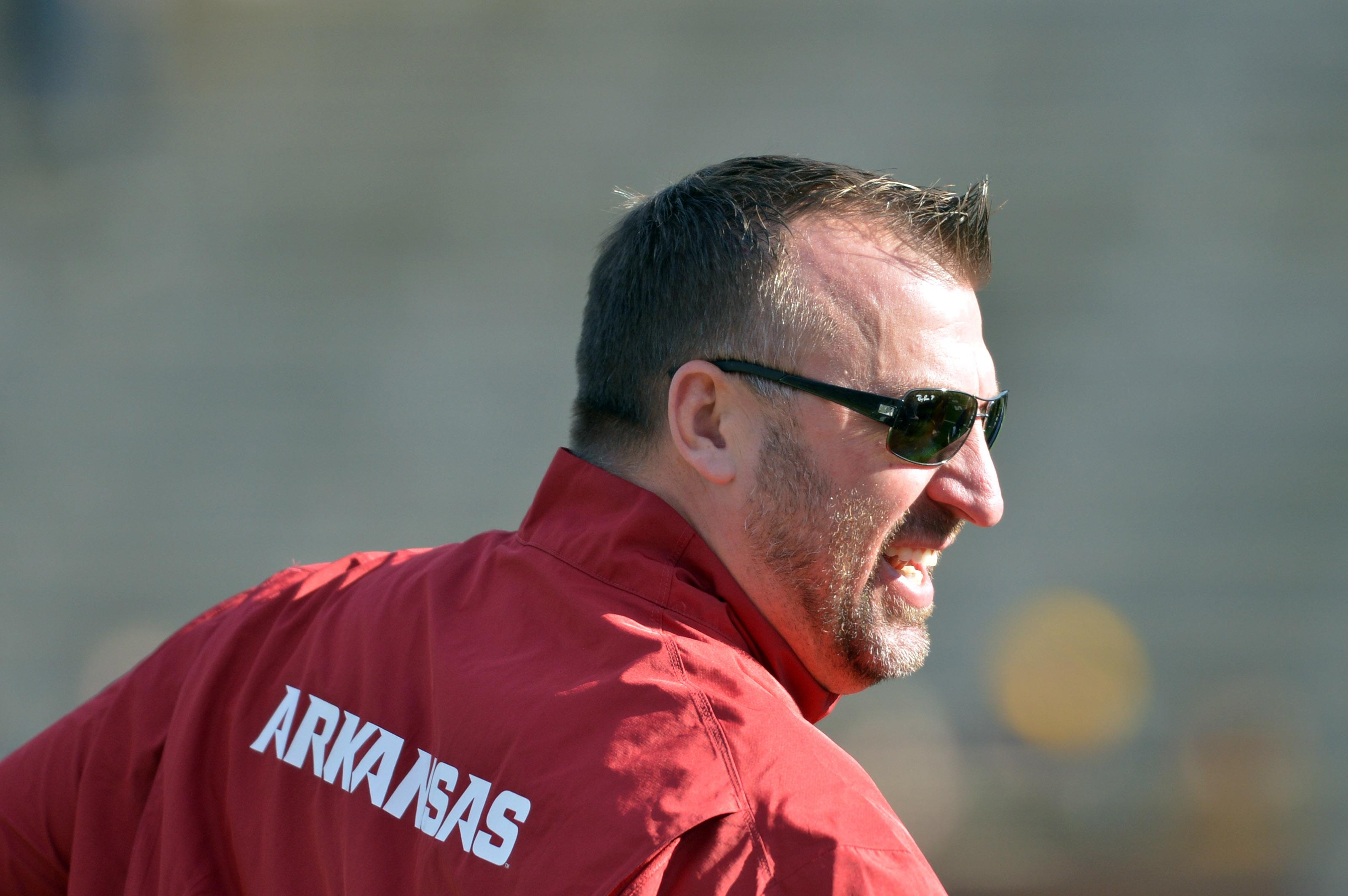 Bret Bielema does 'Horns down' sign in photo with Charlie Strong