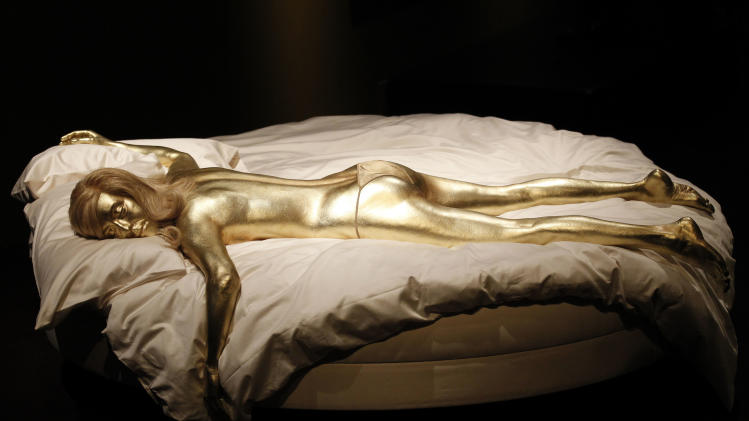 A recreation of Jill Masterson's golden body in the film 'Goldfinger' is seen on display in the exhibition 'Designing 007 - Fifty Years of Bond Style' at the Barbican centre in London, Thursday, July 5, 2012. (AP Photo/Sang Tan)