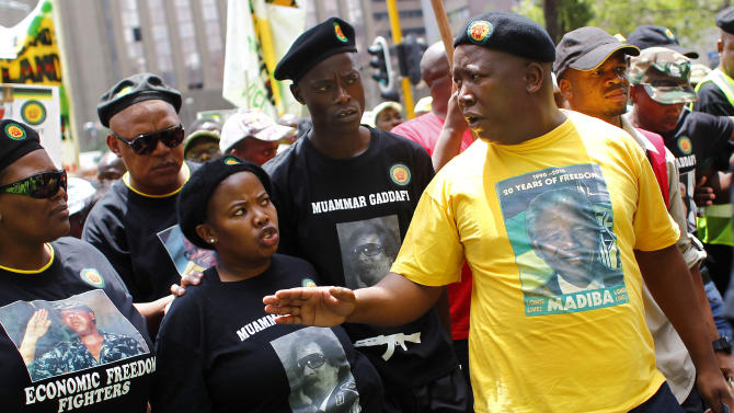 Julius Malema, right, the tough-talking youth leader of the governing African National Congress, leads a crowd of protesters through the central business district, Johannesburg, South Africa, Thursday, Oct. 27, 2011. Young South Africans brought their frustration over poverty and joblessness to the streets Thursday, responding to a call by the tough-talking youth leader of the governing African National Congress who has clashed with older party leaders over economic policy. (AP Photo/Jerome Delay)