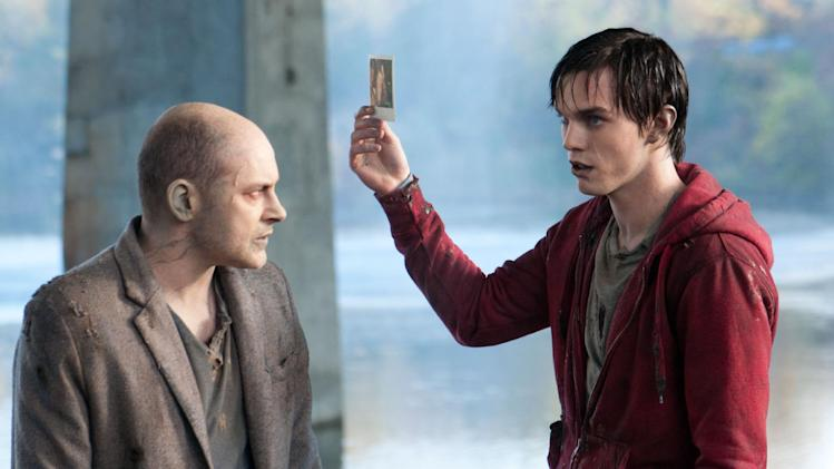 "This film image released by Summit Entertainment shows Rob Corddry, left, and Nicholas Hoult in a scene from ""Warm Bodies."" (AP Photo/Summit Entertainment, Jonathan Wenk)"