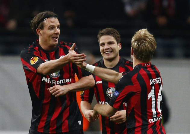 Eintracht Frankfurt's Meier and Aigner celebrate Meier's goal against Porto during their Europa League soccer match in Frankfurt