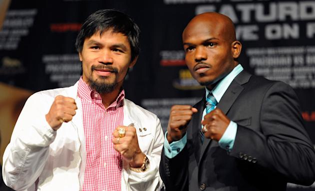 Boxers Manny Pacquiao (L) And Timothy Bradley Pose  Getty Images