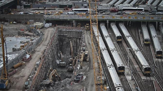 This photo taken on Thursday April 17, 2014, shows ongoing construction of a rail tunnel, left, at the Hudson Yards redevelopment site on Manhattan's west side in New York. Amtrak is constructing an 800-foot-long concrete box inside the project to preserve space for a tunnel from Newark to New York City that would allow it to double rail capacity across the Hudson River. (AP Photo/Bebeto Matthews)