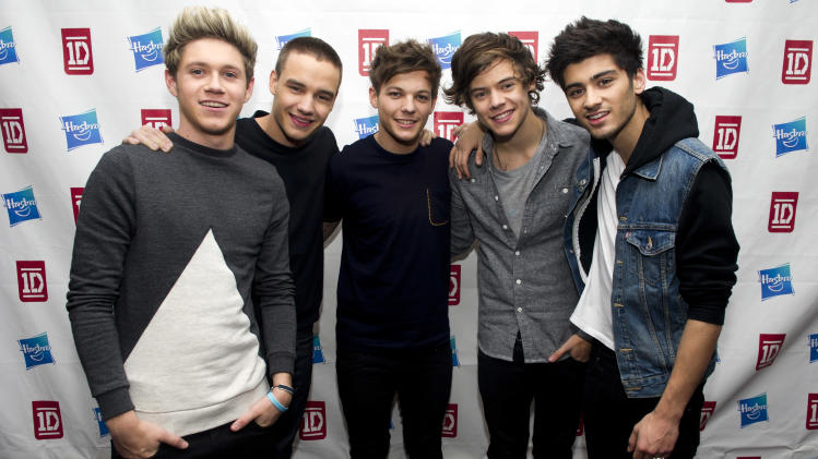 Members of worldwide musical sensation One Direction, from left to right, Niall Horan, Liam Payne, Louis Tomlinson, Harry Styles and Zayn Malik pose at a Hasbro press event on Monday, Nov. 26, 2012 in New York. (Photo by Charles Sykes/Invision for Hasbro/AP Images)