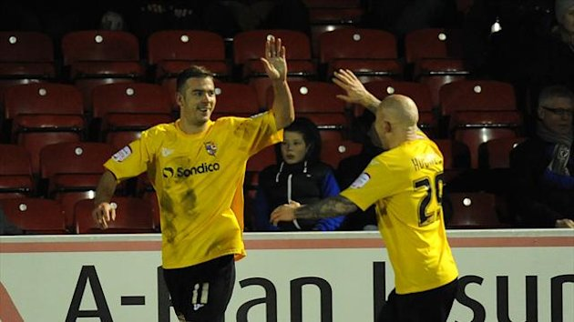Tom Pope, left, was on target for Port Vale