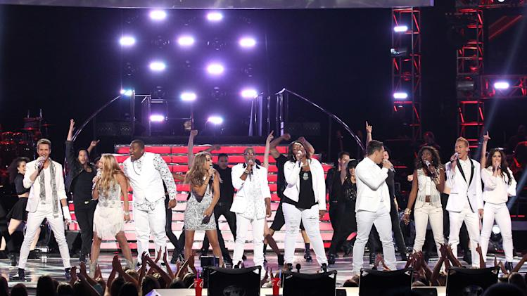 "The top 10 contestants perform in white at the ""American Idol"" finale at the Nokia Theatre at L.A. Live on Thursday, May 16, 2013, in Los Angeles. (Photo by Matt Sayles/Invision/AP)"