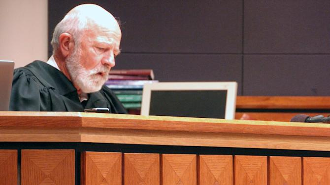 Montana District Judge G. Todd Baugh reads a statement in his Billings courtroom on Friday, Sept. 6, 2013, explaining his 30-day sentence for a teacher who raped a student. Baugh had sought a re-sentencing hearing for defendant Stacey Rambold, but was blocked by the state Supreme Court. (AP Photo/Matthew Brown)