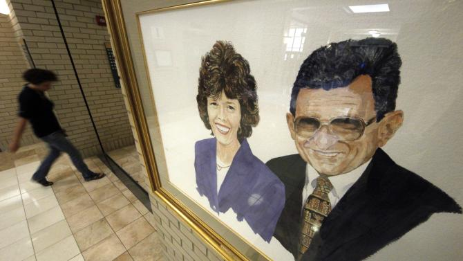A portrait of Sue and Joe Paterno by artist Bill Rettig hangs in the Pattee and Paterno Library on the main campus of Penn State University in State College, Pa., Friday, July 13, 2012.  After an eight-month inquiry, Former FBI director Louis Freeh's firm produced a 267-page report that concluded that Paterno and other top Penn State officials hushed up child sex abuse allegations against former Penn State assistant football coach Jerry Sandusky for more than a decade for fear of bad publicity, allowing Sandusky to prey on other youngsters. (AP Photo/Gene J. Puskar)