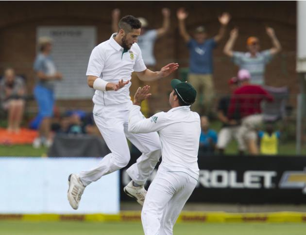 South Africa's Parnell and Elgar celebrate the wicket of Australia's Marsh during the second day of the second cricket test match in Port Elizabeth