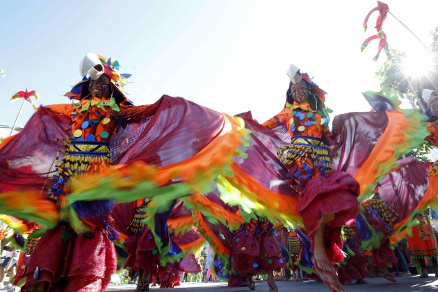 Students wearing colourful nature-inspired costumes perform during the Caracol festival in Makati city, metro Manila
