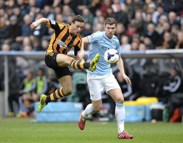 Hull City's Chester challenges Manchester City's Dzeko during their English Premier League soccer match in Hull