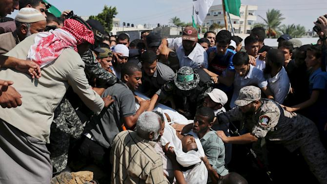 Palestinians bury the body of Jihad Al-Obeed, who was shot dead by Israeli troops on Friday in a cemetery in Deirl al-Balah in the central Gaza Strip