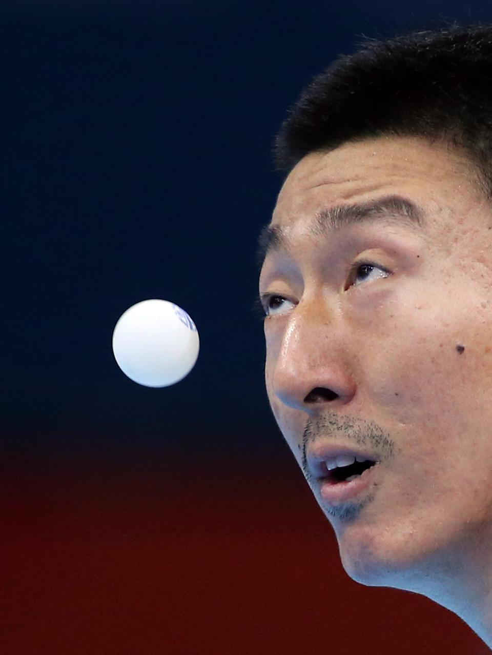 Oh Sangeun of South Korea competes against Kim Hyok Bong of North Korea  during men's team table tennis competition at the 2012 Summer Olympics, Saturday, Aug. 4, 2012, in London. (AP Photo/Sergei Grits)