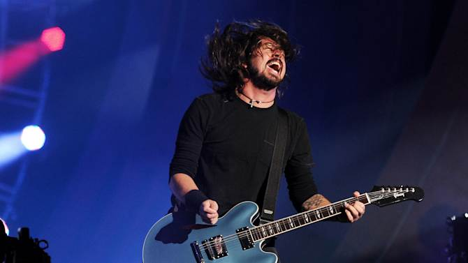 Musician Dave Grohl and the Foo Fighters perform at the Global Citizen Festival in Central Park on Saturday Sept. 29, 2012 in New York. (Photo by Evan Agostini/Invision/AP)