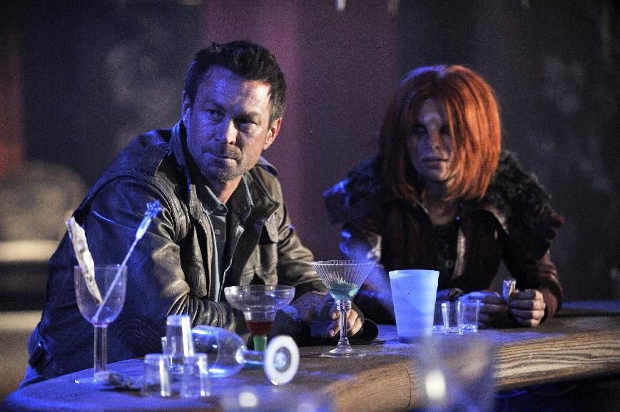 "This publicity image released by Syfy shows Grant Bowler as Jeb Nolan, left, and Stephanie Leonidas, as Irisa, in a scene from the  series, ""Defiance,"" premiering Monday, April 15, 2013 at 9 p.m. EST on Syfy. (AP Photo/Syfy,  Ben Mark Holzberg)"