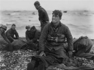 US Army soldiers recover the remains of comrades at Omaha Beach, Normandy, France, in this June 6, 1944 handout photo obtained by Reuters June 1, 2012. REUTERS/U.S. Library of Congress/Handout