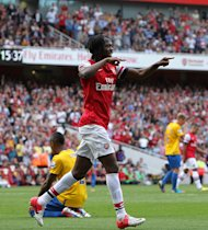 Gervinho, pictured, and Lukas Podolski were on target as Arsenal beat Montpellier