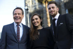 """Cast members Cranston, Olsen and Taylor-Johnson pose at the premiere of """"Godzilla"""" at the Dolby theatre in Hollywood"""