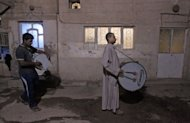 &quot;Mousaherati&quot; beat their drums in the streets of Baghdad&#39;s Sadr City on August 1 to wake the sleeping for the last meal before fasting starts. For Ramadan, security officials have loosened restrictions, allowing mousaherati to move around Samarra