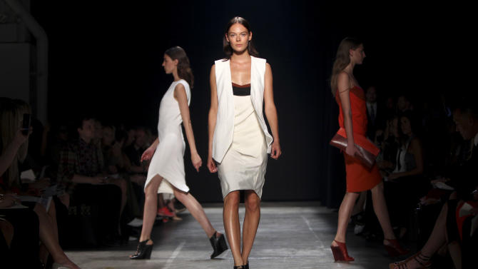 The Narciso Rodriguez Spring 2013 collection is modeled during Fashion Week in New York, Tuesday, Sept. 11, 2012.  (AP Photo/Seth Wenig)