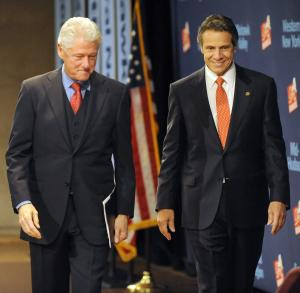 Former President Bill Clinton and New York Gov. Andrew Cuomo arrive for a New York Open for Business Statewide Conference at the Empire State Plaza Convention Center in Albany, N.Y., Tuesday, Oct. 27, 2011. (AP Photo/Hans Pennink)