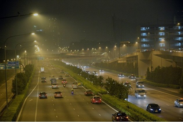 Motorists travel along the hazy Central Expressway in Singapore, on June 19, 2013