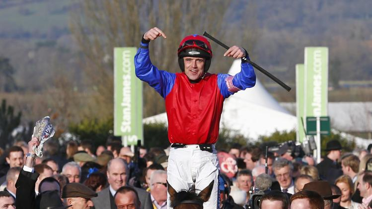 Ruby Walsh on Quevega celebrates after winning the Mares' Hurdle Race during the Cheltenham Festival horse racing meet in Gloucestershire