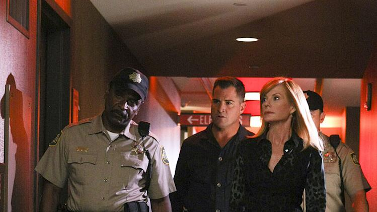 "George Eads, center, as Nick Stokes and Marg Helgenberger as Catherine Willows on ""CSI: Crime Scene Investigation."""