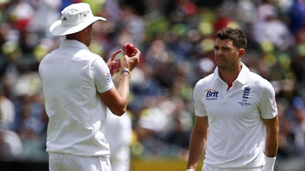 England's Stuart Broad (L) discusses the condition of the ball with team-mate James Anderson (Reuters)