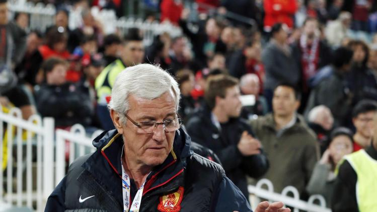 Guangzhou Evergrande's coach Marcello Lippi of Italy looks at the match ball before their AFC Champions League quarter-final soccer match against Western Sydney Wanderers in Sydney