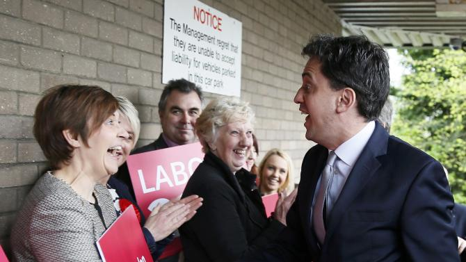 Britain's opposition Labour Party leader Ed Miliband arrives to host a People's Question Time in Kempston