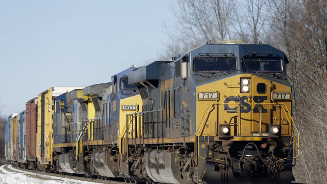 In this Friday, Jan. 18, 2013, photo, a CSX train passes through New Scotland, N.Y. CSX Corp. reports quarterly financial results after the market closes on Tuesday, April 16, 2013. (AP Photo/Mike Groll)