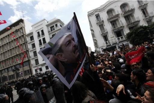 Tunisian protesters shout slogans during demonstration after death of Tunisian opposition leader Belaid, outside the Interior ministry in Tunis