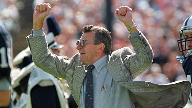 FILE - In this Sept. 12, 1998 file photo, Penn State football coach Joe Paterno cheers on his players as he runs onto the field before a game against Bowling Green in State College, Pa. Paterno say he plans to retire at the end of the season, his long and illustrious career brought down because he failed to do all he could about an allegation of child sex abuse against a former assistant. (AP Photo/Chris Gardner, File)