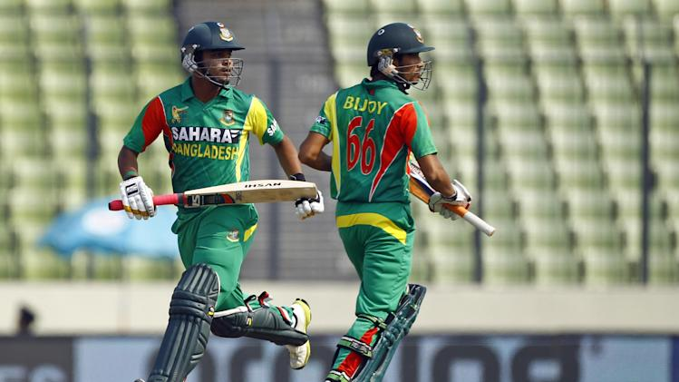 Bangladesh's Shamsur Rahman, left, and Anamul Haque run between the wickets during the Asia Cup one-day international cricket tournament against Sri Lanka in Dhaka, Bangladesh, Thursday, March 6, 2014. (AP Photo/A.M. Ahad)
