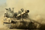 &lt;p&gt;Israeli mobile artillery drives through sandy terrain during a military exercise in the Israeli-occupied Golan Heights, north of Israel on Sepetember 19, 2012. Israel&#39;s army staged a surprise drill on the country&#39;s northern border, the military said, amid tensions over Iran&#39;s nuclear drive and the fate of Syria&#39;s chemical weapons.&lt;/p&gt;