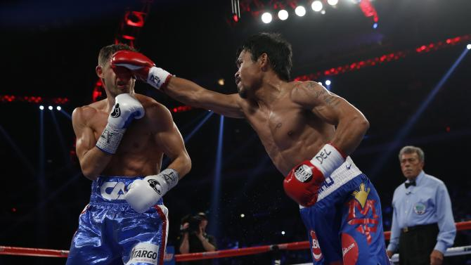 Manny Pacquiao of the Philippines punches Chris Algieri of the U.S. during  their World Boxing Organisation (WBO) 12-round welterweight title fight at the Venetian Macao hotel in Macau