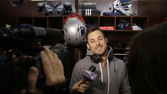 New England Patriots wide receiver Danny Amendola responds to a reporter's questions during a media availability in front of his locker at the NFL football team's facility Wednesday, Nov. 26, 2014 in Foxborough, Mass. The Patriots will play the Green Bay Packers on Sunday in Wisconsin