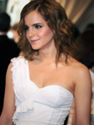 Emma Watson wearing a white one-shouldered custom-made Burberry dress with a central split.