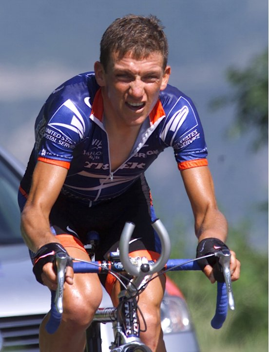 In this June 26, 2001, file photo, Tyler Hamilton fights his way up the hill during the 8th stage of the Tour de Suisse, the mountain time trial from Sion to Crans-Montana in Crans-Montana, Switzerlan