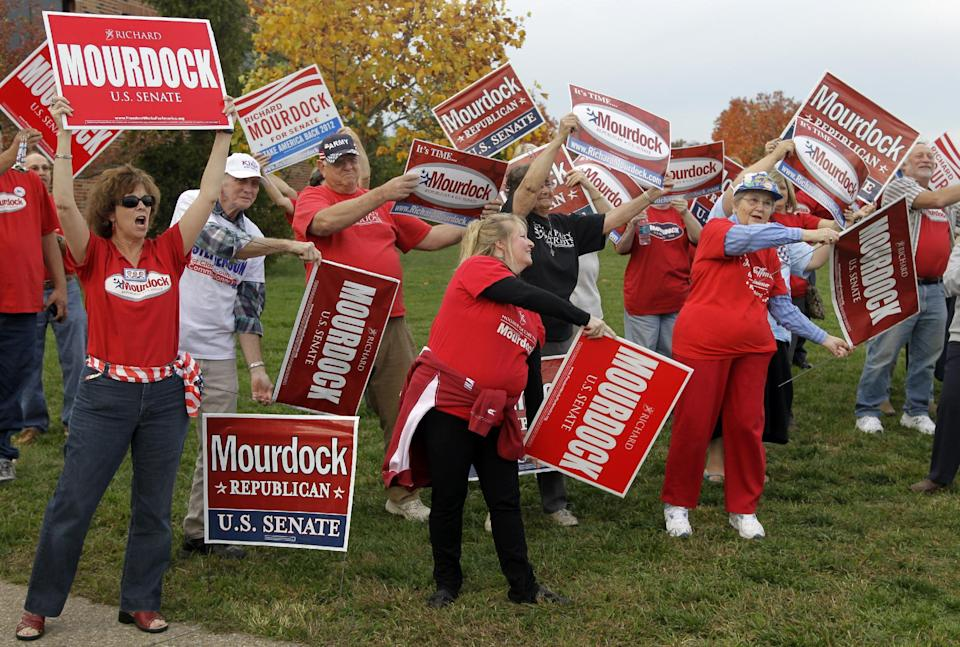 Supporters of Republican Richard Mourdock, candidate for Indiana's U.S. Senate seat, cheer outside the site of a debate between Mourdock, Democrat Joe Donnelly  and Libertarian Andrew Horning in New Albany, Ind., Tuesday, Oct. 23, 2012. (AP Photo/Michael Conroy)