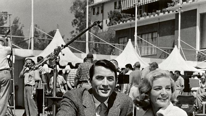 "In this image released by Beverly Hills Collection, actors Gregory Peck, left, and Lauren Bacall are seen while shooting the film ""Designing Woman"" at The Beverly Hills Hotel. The Beverly Hills Hotel is celebrating its 100th Anniversary in May. (AP Photo/Beverly Hills Collection)"