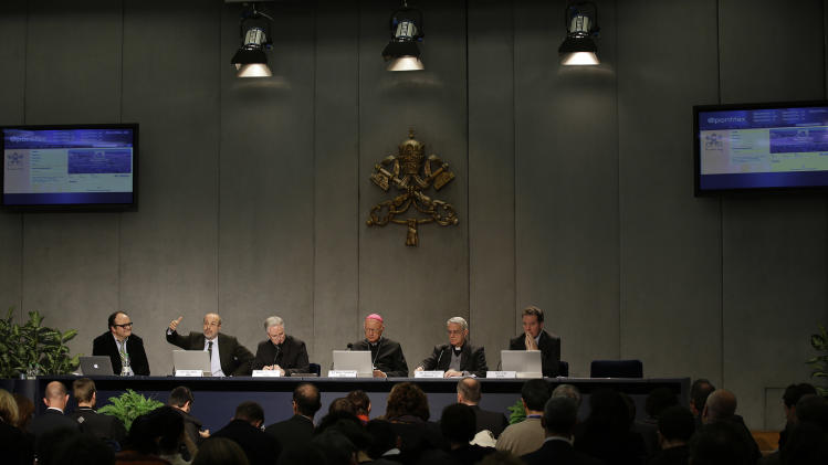 Second from left, Vatican Newspaper Editor in Chief Giovanni Maria Vian,  Monsignor Paul Tighe, Monsignor Claudio Celli, Vatican spokesman Father Federico Lombardi, left, and  Vatican's communications adviser Greg Burke present Pope Benedict XVI's Twitter webpage to journalists at the Vatican press hall, Monday, Dec. 3, 2012. Pope Benedict XVI will start tweeting in six languages from his own personal handle (at)Pontifex on Dec. 12. The Vatican said Monday the pope will be using a question and answer format in his first Tweet, focusing on answering questions about faith — in 140 characters. (AP Photo/Gregorio Borgia)