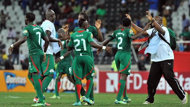 Burkina Faso players celebrate on January 29, 2013 after a 2013 Africa Cup of Nations Group C football match against Zambia at the Mbombela stadium in Nelspruit (AFP)