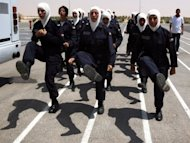 Jordanian policewomen are put through their paces at the al-Muwaqr academy. FIFA, world football&#39;s governing body, banned players from wearing the Islamic headscarf in 2007, claiming it is unsafe, but the International Football Association Board (IFAB) allowed women players last month to wear the hijab in games