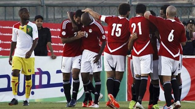 Egypt's Mohamed Aboutrika (2nd L) celebrates with team-mates after scoring a goal against Guinea during their 2014 World Cup qualifier (Reuters)